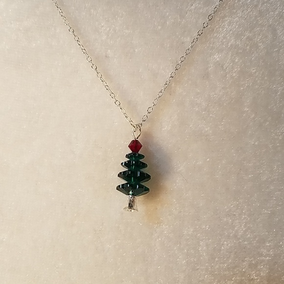 Avon jewelry christmas tree necklace by poshmark christmas tree necklace by avon aloadofball Image collections